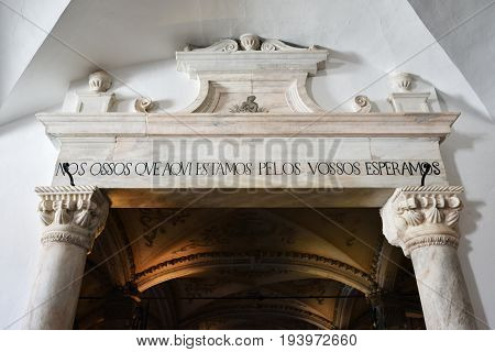 Evora, Portugal - June12 2017: Entrance in Chapel of Bones is one of the best known monuments in Evora. The message above entrance means: