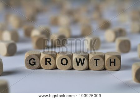 Growth - Cube With Letters, Sign With Wooden Cubes