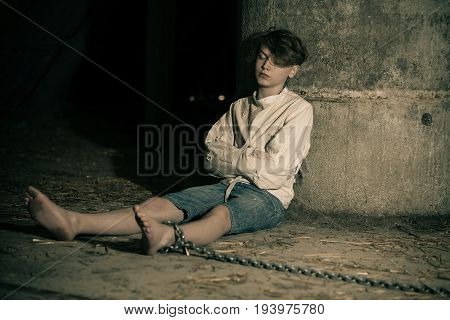 Teenage Boy Being Kept Captive In An Attic
