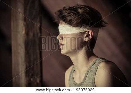 Teenage Boy Tied Up In A Blindfold