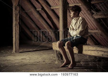 Barefoot Teenage Boy In A Straight Jacket