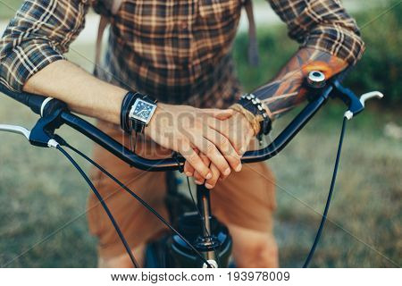 Unrecognizable Young Man Put His Hands On The Wheel Of A bicycle Destination Relaxation Resting Concept