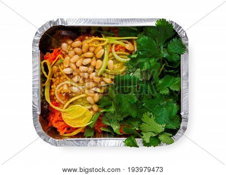 Healthy lunch in foil box, top view isolated on white. Meals take away and delivery. Salad with cedar nuts
