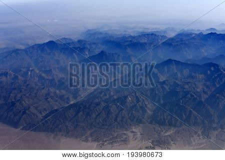 Aerial View Of The Landscape With White Mist Rocky Mountains