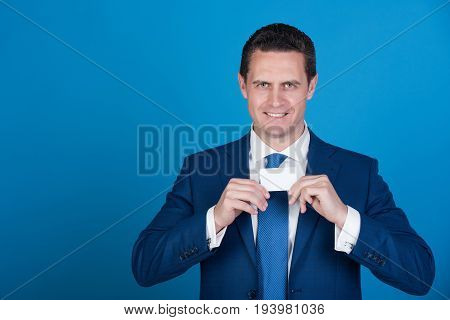 Manager Smiling With Bank Or Business Card