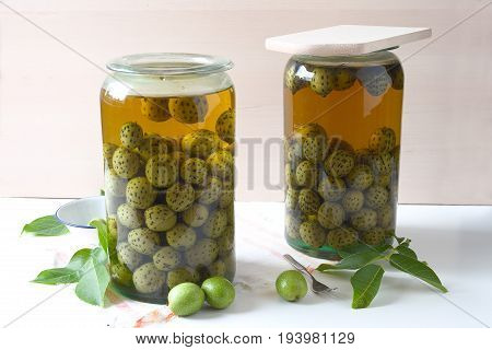 PICKLED GREEN BLACK WALNUTS. Green nuts get watered for 14 days, than cooked and soaked in a spicy, sweet syrup.