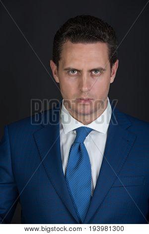 Businessman Posing In Elegant Blue Jacket And Tie