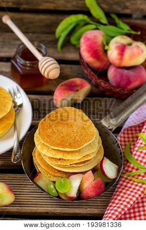 Sweet semolina pancakes with donut peaches and grapes