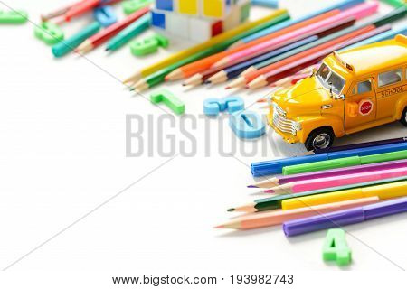Colorful back to school supplies border over white table. Mental arithmetic. Space for text.