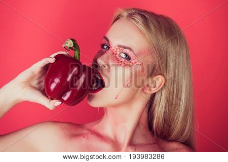 Pretty Blonde Woman With Creative Fashionable Makeup Bite Bell Pepper
