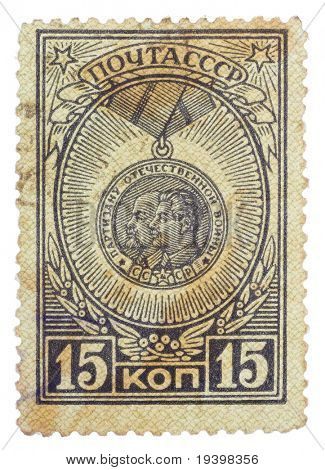 RUSSIA - CIRCA 1946: stamp printed in USSR, shows partisans awards with portraits her leaders - Joseph Stalin and Vladimir Lenin, circa 1946