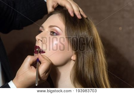 Fashion Model Getting Lips Painted In Beauty Salon