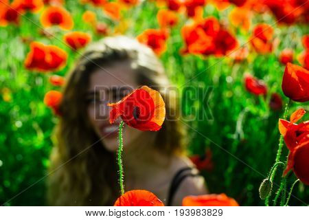 Poppy Seed At Girl With Long Curly Hair