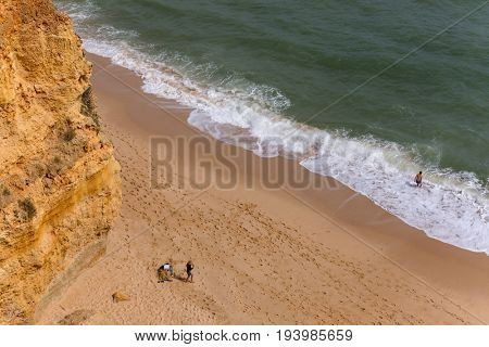 PRAIA DA MARINHA, ALGARVE, PORTUGAL - APRIL 24, 2017: People at the Praia da Marinha, Armacao de Pera, Algarve, Portugal