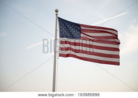 View of Flag of the United States of America waving at sunset
