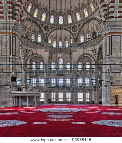Istanbul, Turkey - April 25, 2017: Fatih Mosque a public Ottoman mosque in the Fatih district of Istanbul Turkey with a huge decorated domes & many colored stained glass windows