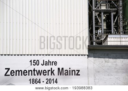 MAINZ, GERMANY - JUNE 10: The logo of the company Heidelberg Zement with the year of its foundation on the outer facade of an industrial building on June 10 2017 in Mainz.