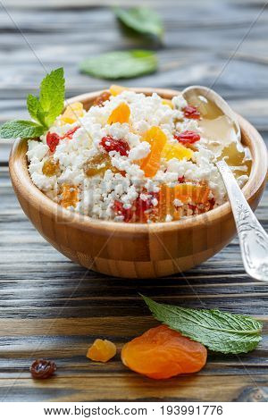 Cottage Cheese With Dried Fruit And Honey In A Bowl.