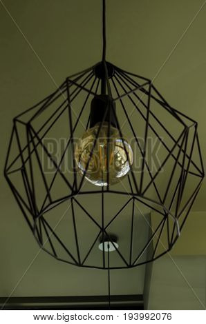 Decorative lampshade or chandelier from metal and lamp in room, Sofia, Bulgaria