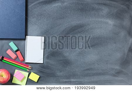 Back to School chalk board with apple and writing materials