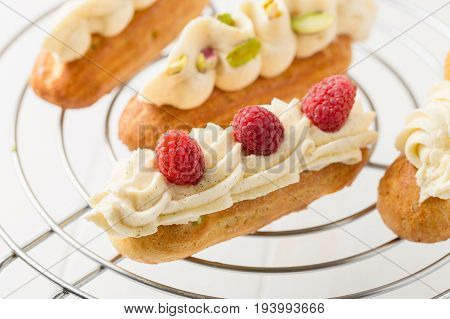 Eclair With Vanilla Cream And Raspberries