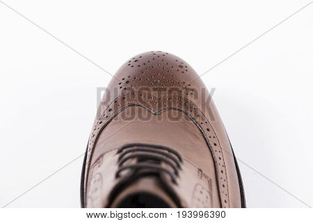 Male Brown Shoe on White Background, Isolated Product, Top View, Studio.