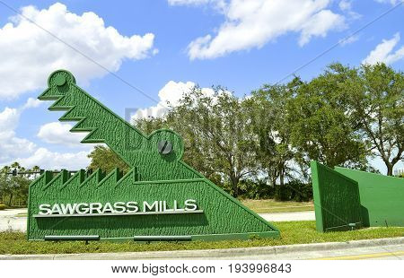 Sawgrass Mills Shopping Outlet Mall Broward County Fort Lauderdale Florida USA - May 15 2017 : Sawgrass Mills sign at the entrance to the shopping mall operated by the Simon Property Group