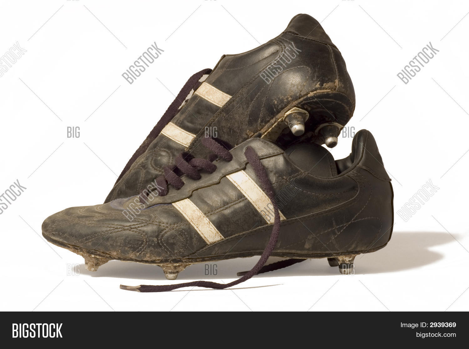 0abf479b7 A pair of old football boots showing signs of good use and age