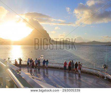 Bora Bora, French Polynesia - September 28, 2012 : Cruise Ship Passengers Watch The Sunrise Over Bor