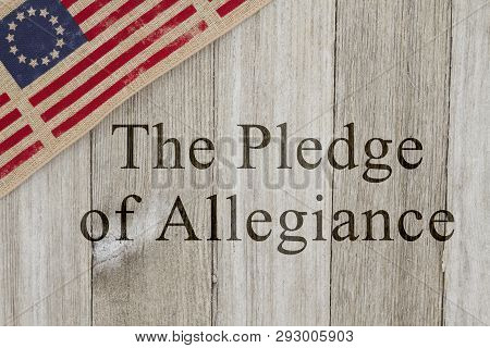 America Patriotic Message, Usa Patriotic Old Flag On A Weathered Wood Background With Text The Pledg