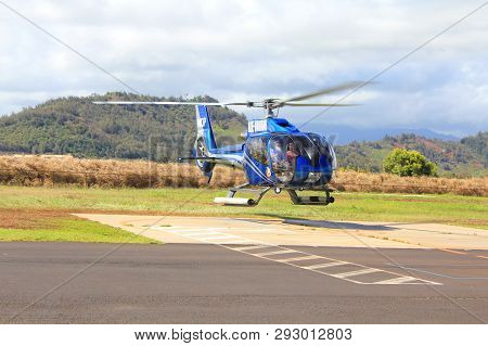 Kauai, Hawaii - September 20 : Blue Hawaiian Helicopter Landing On Heliport On September 20, 2012 In
