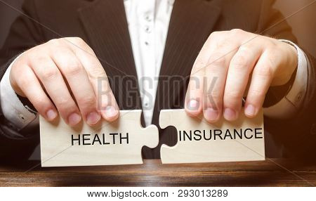 Businessman Collects Wooden Blocks With The Word Health Insurance. Health Care Concept. Cash Costs F