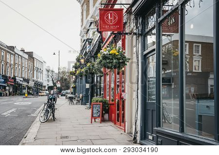London, Uk - March 23, 2019: Rows Of Shops In Belsize Park, Woman Walking On The Background. Belsize