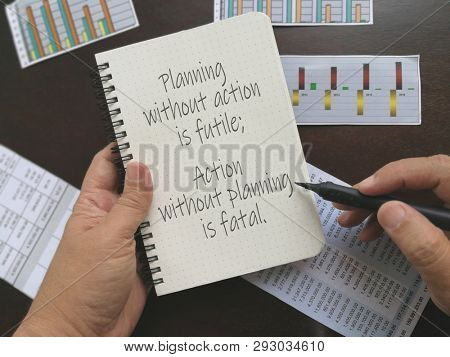 Action and planning quotes, written on notebook