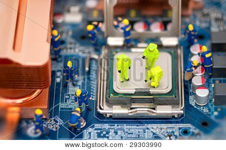 Group Of Technicians Repair Computer