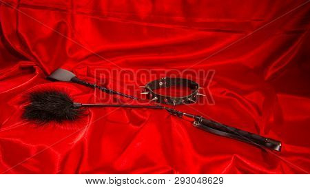 Bondage, Kinky Adult Sex Games, Kink And Bdsm Lifestyle Concept With A Whip, Feather Stick, Collar O