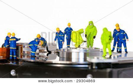 Team of technicians repair hard disk. Hard Drive repair concept poster