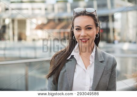 Smiling young business woman portrait