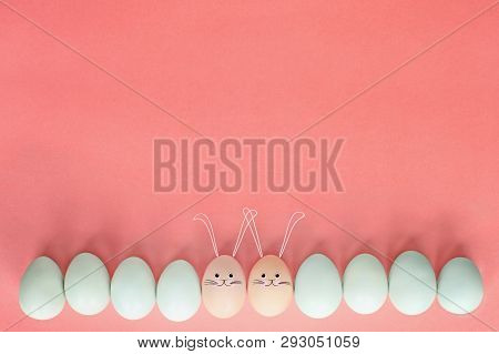 Decorated Easter Eggs With Cute Bunny Face And Ears Drawn On Over A Pastel Background With Room For