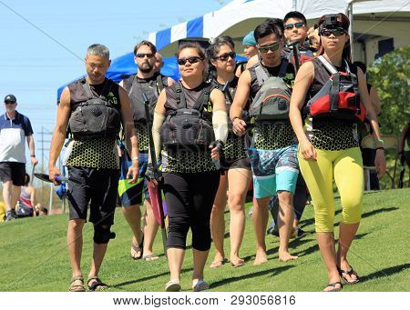 Tempe, Arizona / United States - March 30, 2019: Members Of The Dragon Racers Walk Toward The Dock A