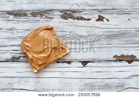 Open Faced Peanut Butter Sandwich On Oat Bread, Over A Rustic White Wooden Table / Background. Top V