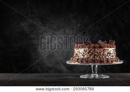 Chocolate cake on dark background