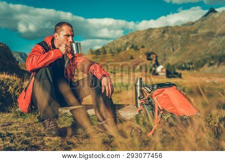 Caucasian Hiker Warming Up By Drinking Hot Tea From Metallic Cup.