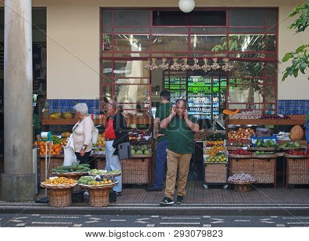Funchal. Madeira, Portugal - 15 March 2019: Grocers Outside A Shop Selling Fruit And Vegetables In F