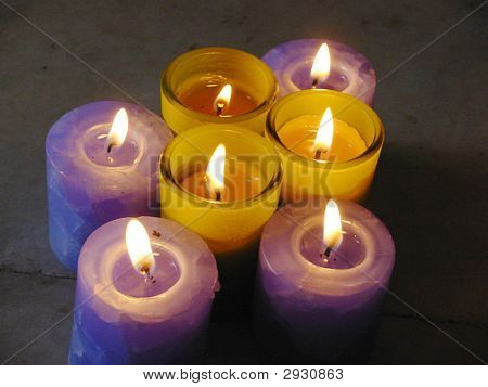 Close-view of lighted candles kept in
