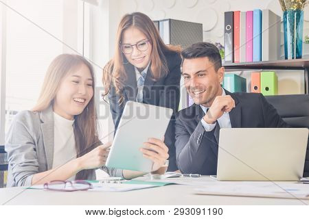 Cheering Happy Business People , Happy Business Team With Arm Raised Sitting In Office During An Off