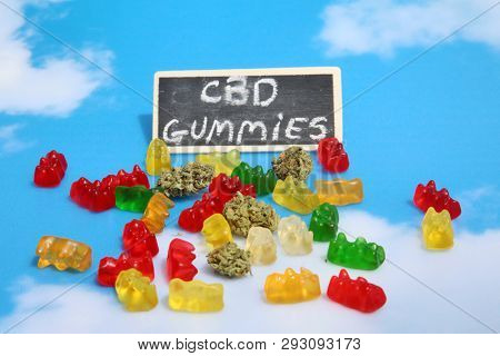 Marijuana Edibles. Cannabis Edibles. THC Infused Gummy Bears. CBD Infused Gummy Candies. Medical Cannabis. Recreational Marijuana. On a blue sky background.