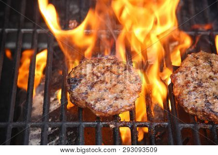 Hamburger. Hamburger grilled on a barbecue. Outdoor cooking. beef burger. ground meat cooking on bbq.