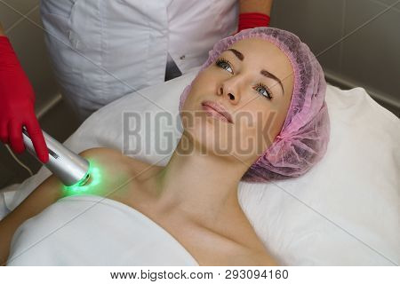 Ultrasound chromotherapy. Hardware cosmetology. Beautician carries out procedure for tightening skin of face. Spa. Non-surgical cosmetology. Restoration of skin elasticity poster