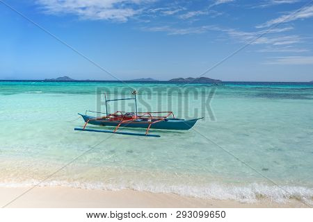 Boat Docked On A Beautiful Tropical Island Beach.
